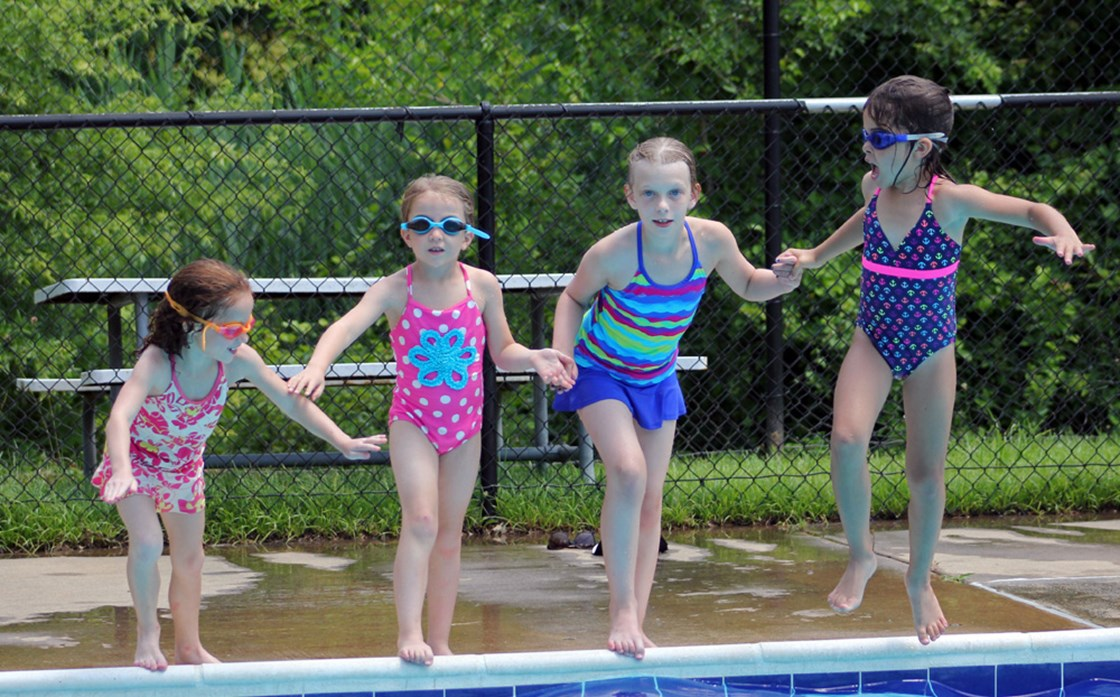 4 girls jumping into pool_edited-1.jpg